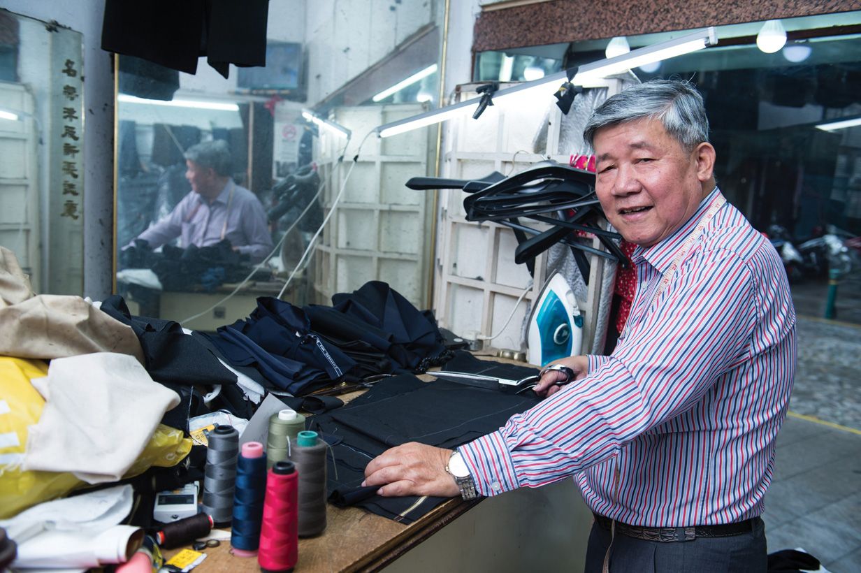 Kuok Nai Un says the shop turns out about 20 suits a month